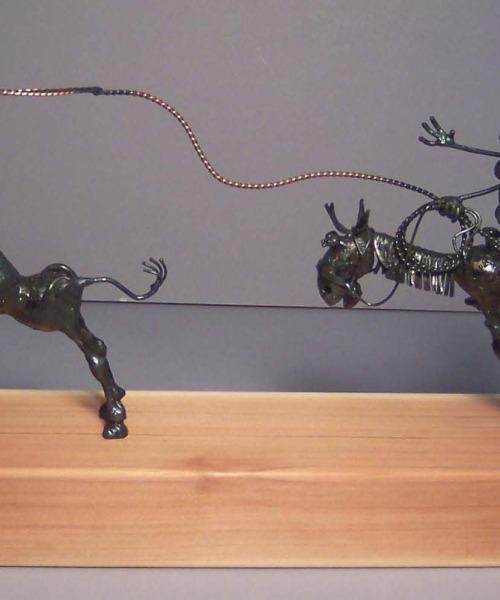 Cowboy roper chasing steer