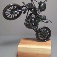 Dirt motorcycle, wheelie
