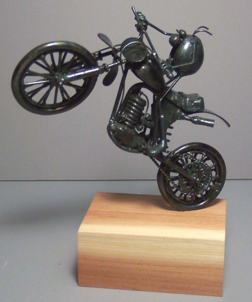Dirt motorcycle, wheelie
